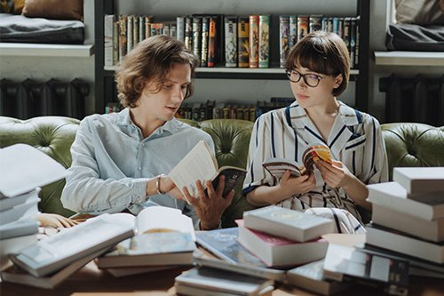 two people reading books